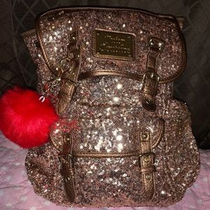 Juicy Couture rose gold sequined backpack.
